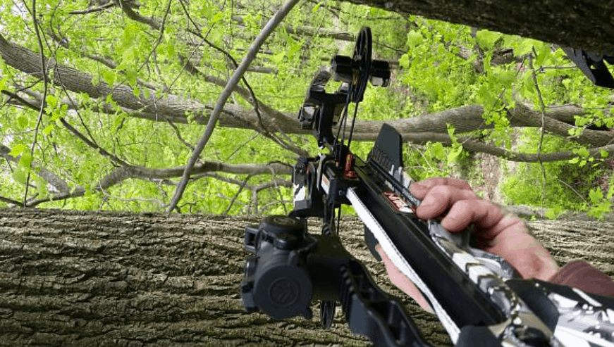 hunter on the field with ravin crossbow