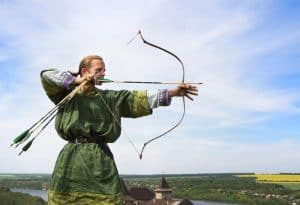 Traditional Archer draw the recurve bow