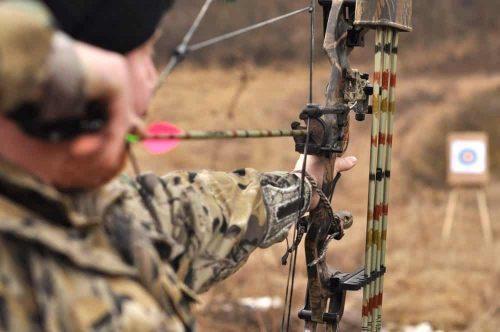 Field Archer shots an arrow
